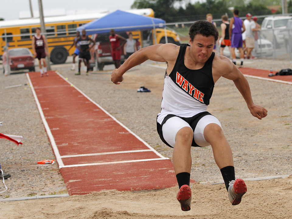 Photo - HIGH SCHOOL TRACK AND FIELD: Josh Ray, of Wayne High School, participates in the boys 2A long jump during a track meet at Carl Albert High School in Midwest City, Friday, May 4, 2012.  Photo by Garett Fisbeck, For The Oklahoman