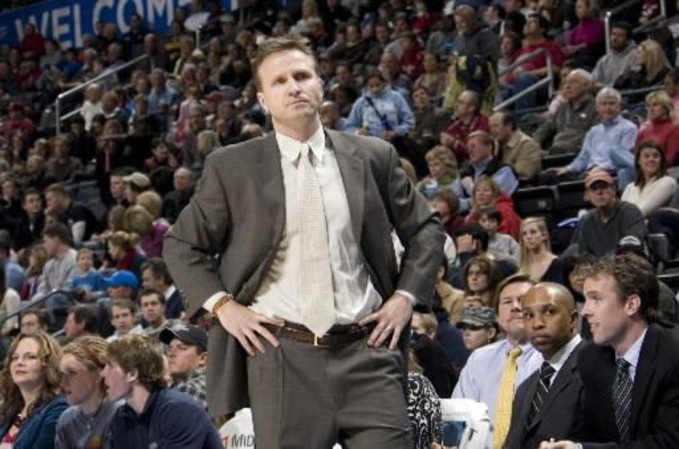 Photo - Oklahoma City head coach  Scott  Brooks reacts during the NBA basketball game between the Oklahoma City Thunder and the Los Angeles Clippers at the Ford Center in Oklahoma City, Tuesday, Dec. 16, 2008. PHOTO BY SARAH PHIPPS