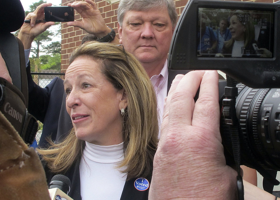Photo - Elizabeth Colbert Busch, the sister of political satirist Stephen Colbert, speaks to the media after voting Tuesday, May 7, 2013, in Charleston, S.C. Colbert Busch, 58, is running against Former South Carolina Gov. Mark Sanford for the 1st District congressional seat. (AP Photo/Bruce Smith)