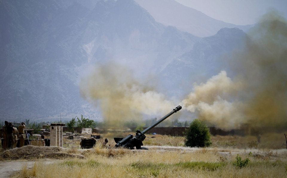 Photo - FILE - In this Wednesday, June 1, 2011, file photo, Pakistani troops fire heavy artillery toward alleged militants hideouts in the mountain ranges in Mamad Gat in Pakistan's Mohmand tribal region along the Afghan border. The Pakistani army said it has launched a