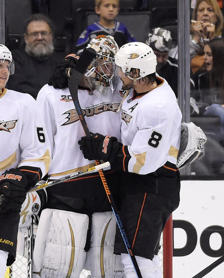 Photo - Anaheim Ducks right wing Teemu Selanne, of Finland, congratulates Anaheim Ducks goalie John Gibson after Game 4 of an NHL hockey second-round Stanley Cup playoff series, Saturday, May 10, 2014, in Los Angeles. The Duck won 2-0. (AP Photo/Mark J. Terrill)