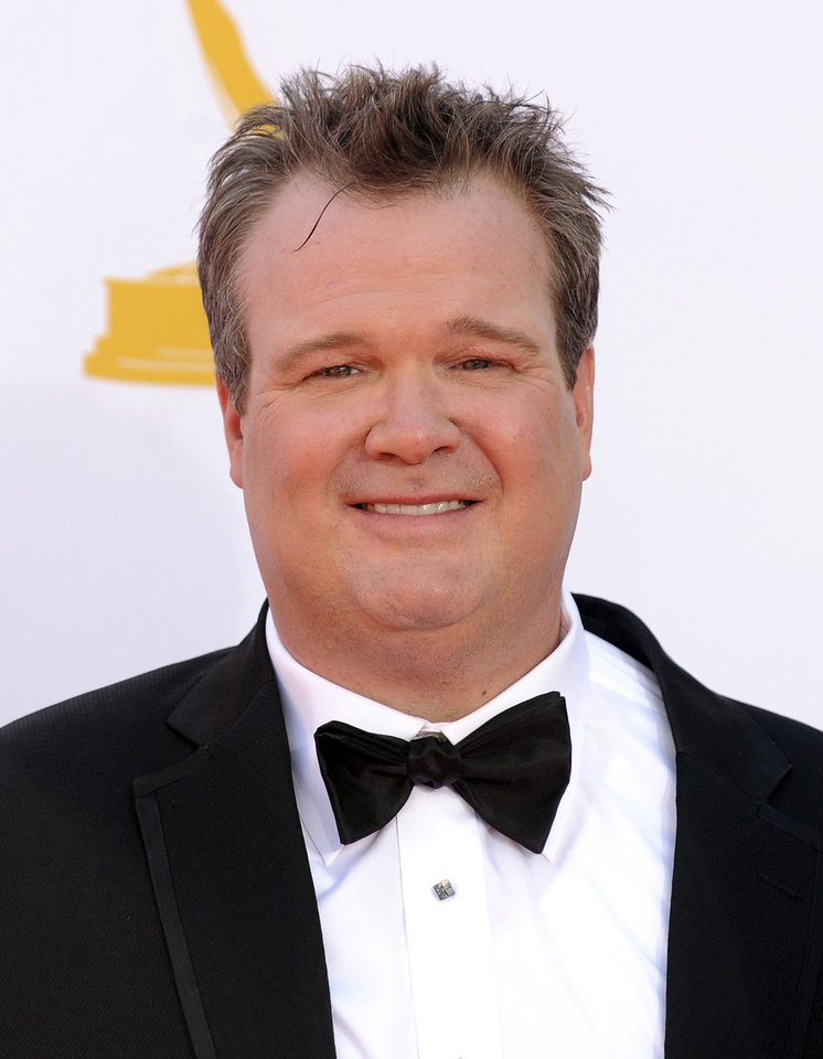 "Actor Eric Stonestreet arrives at the 64th Primetime Emmy Awards at the Nokia Theatre on Sunday, Sept. 23, 2012, in Los Angeles. Stonestreet is nominated for best supporting actor in a comedy for his role on ""Modern Family."" (Photo by Jordan Strauss/Invision/AP)"