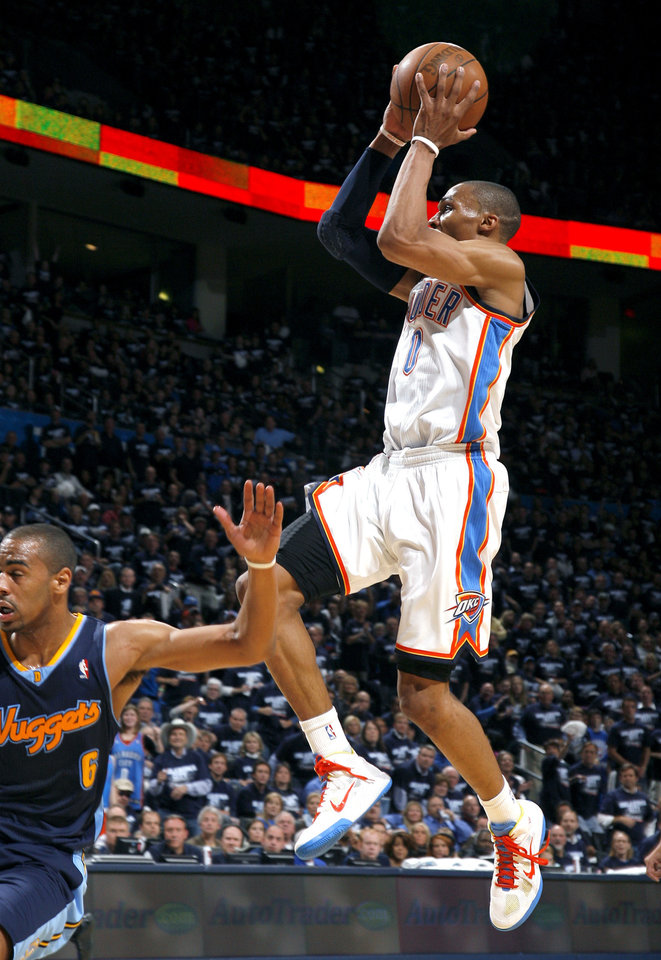 Oklahoma City's Russell Westbrook (0) shoots over Denver's Arron Afflalo (6)during the NBA basketball game between the Denver Nuggets and the Oklahoma City Thunder in the first round of the NBA playoffs at the Oklahoma City Arena, Wednesday, April 27, 2011. Photo by Sarah Phipps, The Oklahoman