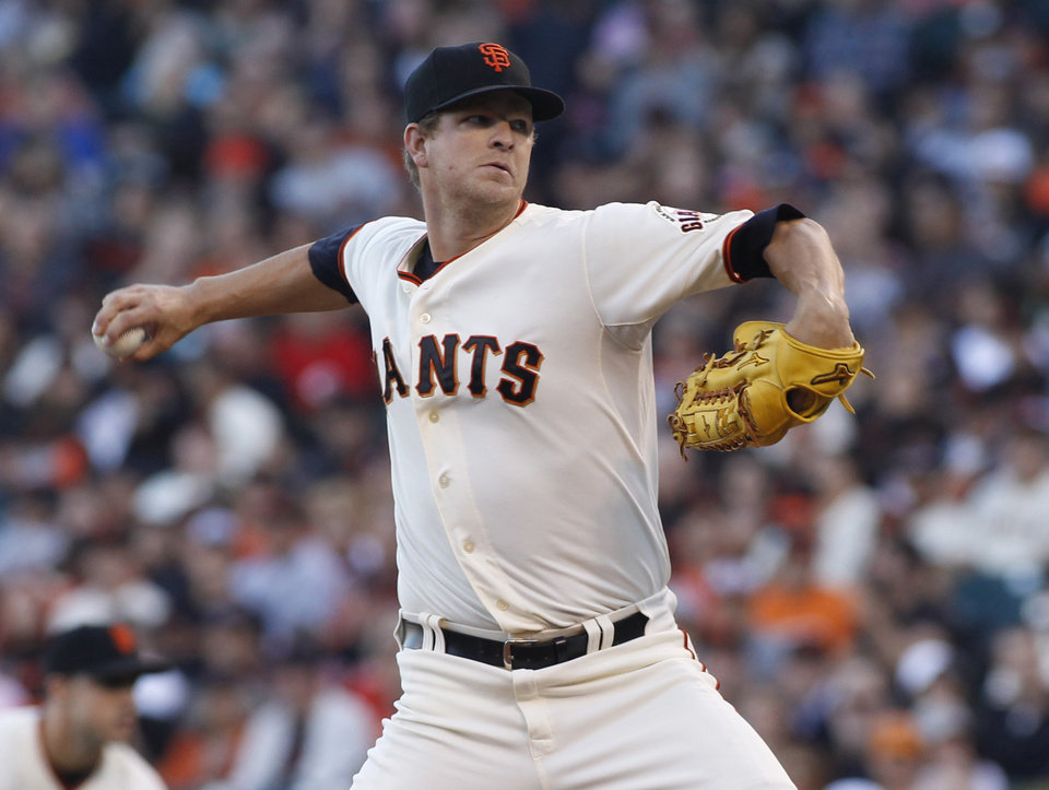 Photo - San Francisco Giants pitcher Matt Cain throws to the Cincinnati Reds during the first inning of a baseball game, Saturday, June 28, 2014, in San Francisco.  (AP Photo/George Nikitin)