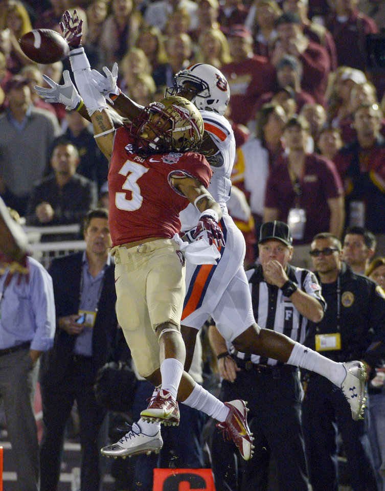 """Photo - FILE - In this Jan. 6, 2014, file photo, Florida State's Ronald Darby (3) breaks up a pass intended for Auburn's Sammie Coates during the first half of the BCS National Championship NCAA college football game in Pasadena, Calif. The Florida State defensive backfield has dubbed itself the """"The No Fly Zone"""" after finishing 2013 as the No. 1 pass defense in the country and setting a school record with 26 interceptions. The top-ranked Seminoles will have the opportunity to live up to the moniker when they face Oklahoma State in Arlington, Texas on Saturday. (AP Photo/Mark J. Terrill, File)"""