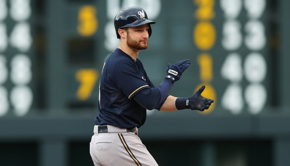 Photo - Milwaukee Brewers' Jonathan Lucroy celebrates after driving in two runs with a single against the Colorado Rockies in the fifth inning of a baseball game in Denver, Sunday, June 22, 2014. (AP Photo/David Zalubowski)