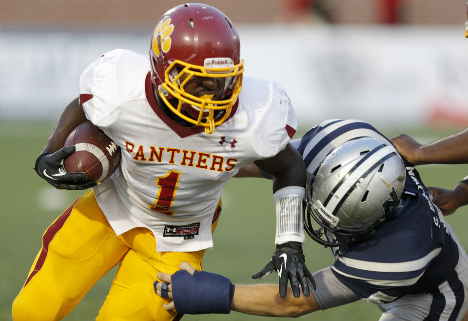 Putnam City North's Tae Moore pushes past Edmond North's Sam Brown during a high school football game at Wantland Stadium in Edmond, Okla., Friday, September 21, 2012. Photo by Bryan Terry, The Oklahoman