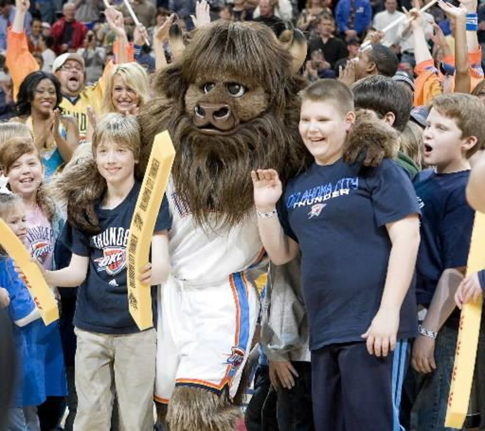 Photo - Rumble the  bison is introduced to the crowd during the NBA basketball game between the New Orleans Hornets and the Oklahoma City Thunder at the Ford Center,Tuesday, Feb. 17, 2009. PHOTO BY BRYAN TERRY