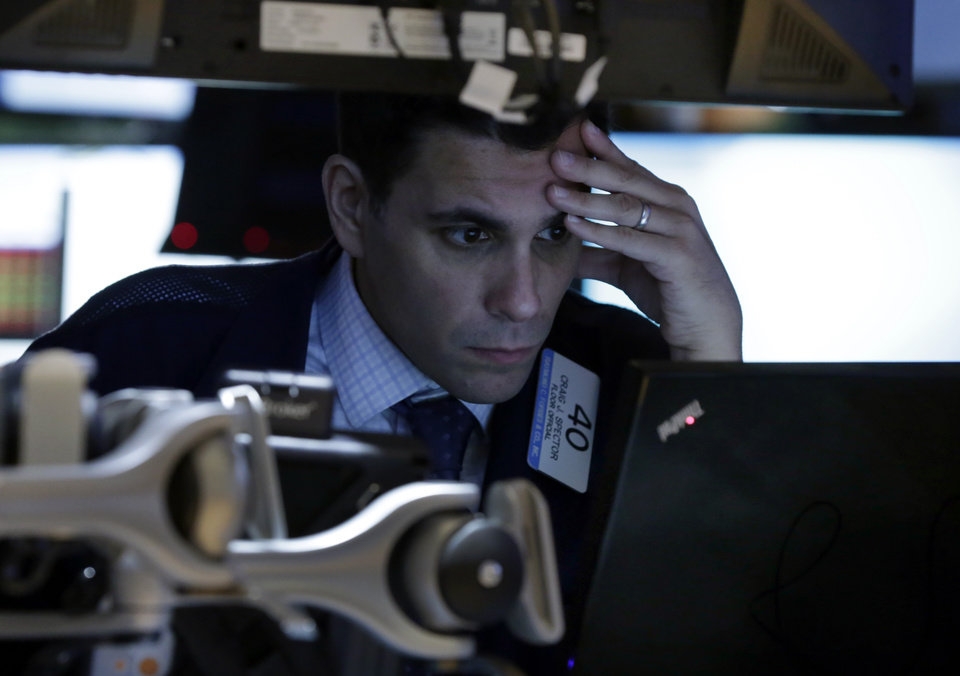 Photo - FILE - In this Monday, March 3, 2014, file photo, trader Craig Spector works on the floor of the New York Stock Exchange. (AP Photo/Richard Drew, File)