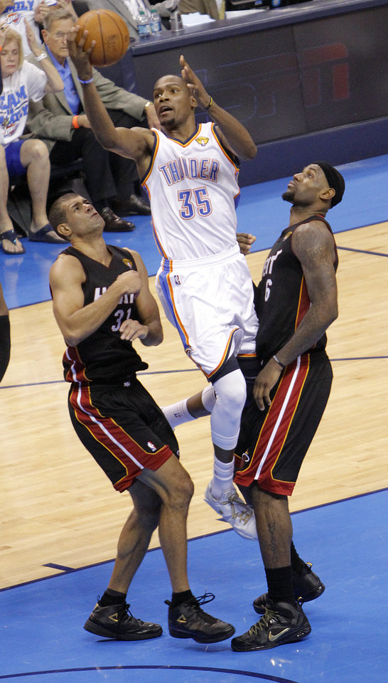 Oklahoma City's Kevin Durant (35) shoots over Miami's Shane Battier (31) and Miami's LeBron James during Game 2 of the NBA Finals between the Oklahoma City Thunder and the Miami Heat at Chesapeake Energy Arena in Oklahoma City, Thursday, June 14, 2012. Photo by Chris Landsberger, The Oklahoman