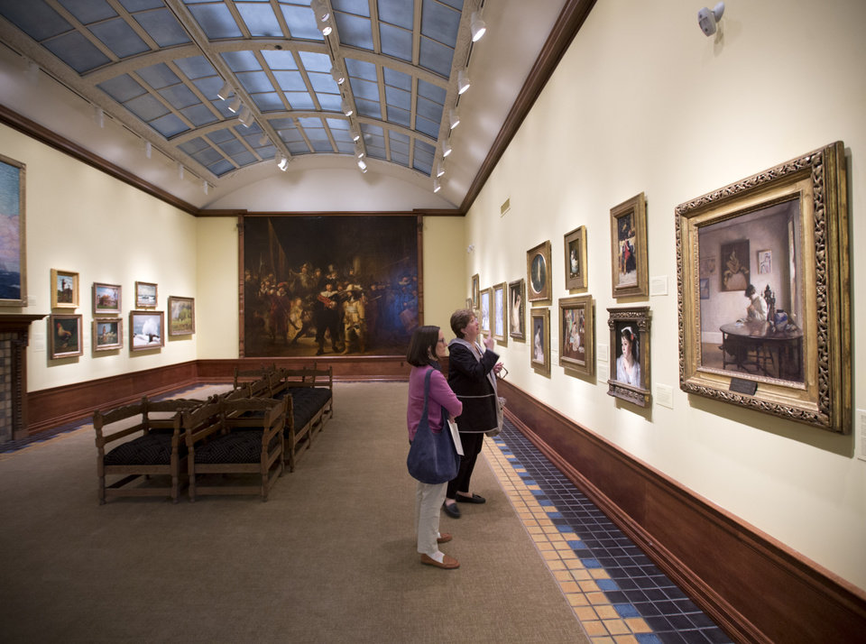 Photo - This May 2, 2014 photo shows Regina Bryde of Delmar, N.Y., left, and Sara Holmes of Syracuse, N.Y., viewing paintings at the Arkell Museum in Canajoharie, N.Y. The museum, started in 1928 by Bartlett Arkell, founder of the Beech-Nut food company, is located next door to company's former plant in Canajoharie, population 2,200. (AP Photo/Mike Groll)