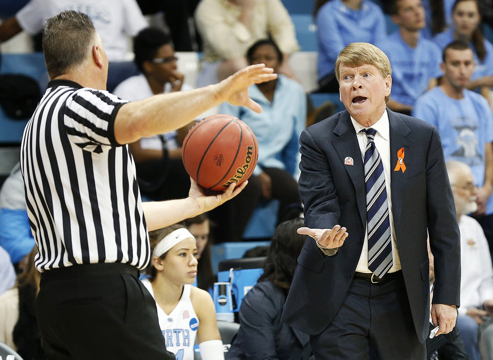 Photo - North Carolina associate head coach Andrew Calder, right, questions a call by an official during the second half of a first-round game of the NCAA college basketball tournament against UT-Martin in Chapel Hill, N.C. Sunday, March 23, 2014. (AP Photo/Ellen Ozier)