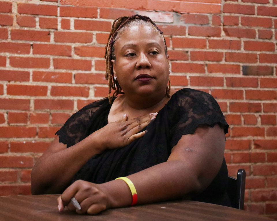 Photo -  The Rev. Sheri Dickerson, a co-founder of Black Lives Matter in Oklahoma City, said the local organization helps meet the needs of neighborhoods through advocacy and community service. The group pushed for the use of body cameras on police officers, wants to increase education for interacting with police on the streets and boost voter registration. [Photo by Doug Hoke, The Oklahoman]