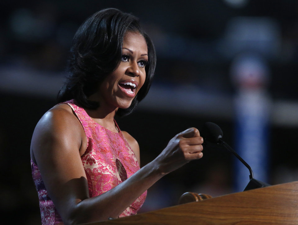 Photo - First Lady Michelle Obama addresses the Democratic National Convention in Charlotte, N.C., on Monday, Sept. 3, 2012. (AP Photo/Jae C. Hong)  ORG XMIT: DNC813