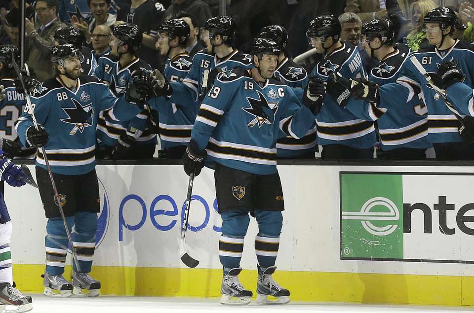 San Jose Sharks center Joe Thornton (19) celebrates after scoring a goal during the second period of an NHL hockey game against the Vancouver Canucks in San Jose, Calif., Monday, April 1, 2013. (AP Photo/Jeff Chiu)