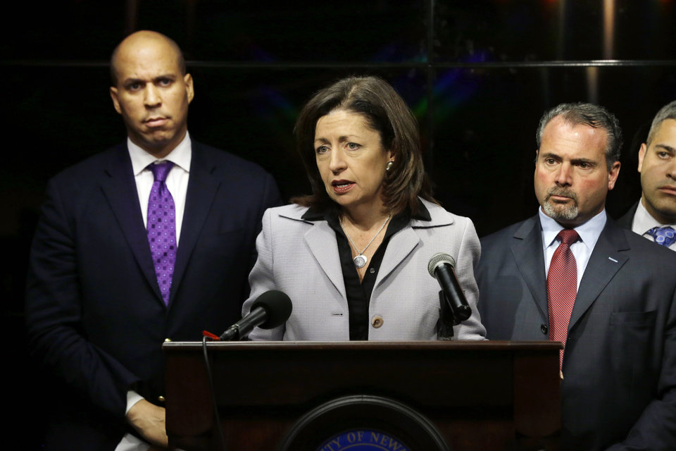 Photo - New Jersey Essex County Prosecutor Carolyn A. Smith talks about charges at a news conference in Newark, on Wednesday, Feb. 13, 2013,  after a video that surfaced showing a naked young man being whipped because of his father's debt. The men identified are 22-year-old Ahmad Holt, 31-year-old Raheem Clark and 23-year-old Jamaar Gray. Police say Holt administered the beating, using a belt provided by Clark. Charges include robbery and aggravated assault.   The video shows a 21-year-old man being forced to strip and then whipped with a belt, supposedly because his father owed someone $20. Subsequent to the police investigation, Nicole A. Smith was arrested for drug possession. (AP Photo/Mel Evans)