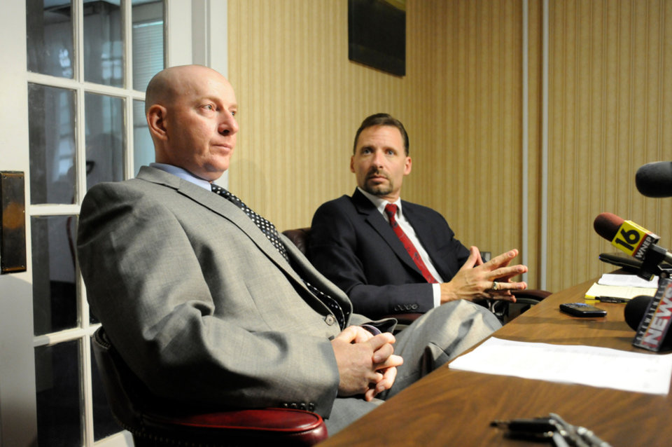 In an Aug. 6, 2013 photo, Gilberton Police Chief Mark Kessler, foreground, and his attorney Joseph P. Nahas, Esq. speak during a press conference at Nahas' office in Frackville, Pa. Kessler says he expects to be fired for posting incendiary videos in which he rants obscenely about the Second Amendment and liberals while spraying machine-gun fire with borough-owned weapons. (AP Photo/Republican-Herald, Jacqueline Dormer)