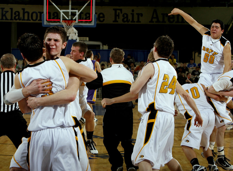 Photo - Roff celebrates during the final of the Class B boys basketball state tournament  between Roff and Red Oak at the State Fair Arena, Saturday, March 6, 2010, in Oklahoma City. Photo by Sarah Phipps, The Oklahoman