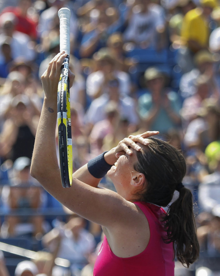 Photo -   Italy's Roberta Vinci celebrates after winning her match against Slovakia's Dominika Cibulkova in the third round of play at the 2012 US Open tennis tournament, Saturday, Sept. 1, 2012, in New York. (AP Photo/Mel C. Evans)