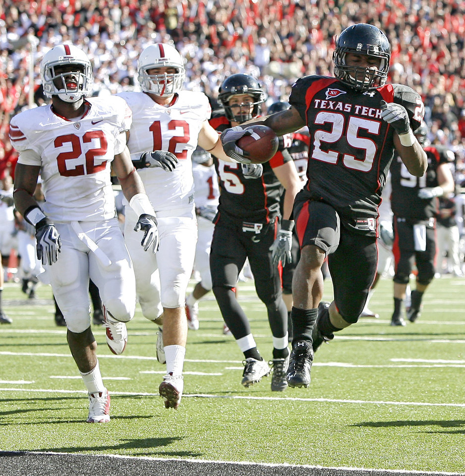 Photo - Texas Tech's Baron Batch scores a touchdown in front of OU's Keenan Clayton, left, and Austin Box during the college football game between the University of Oklahoma Sooners (OU) and Texas Tech University Red Raiders (TTU ) at Jones AT&T Stadium in Lubbock Okla., Saturday, Nov. 21, 2009. Photo by Bryan Terry, The Oklahoman