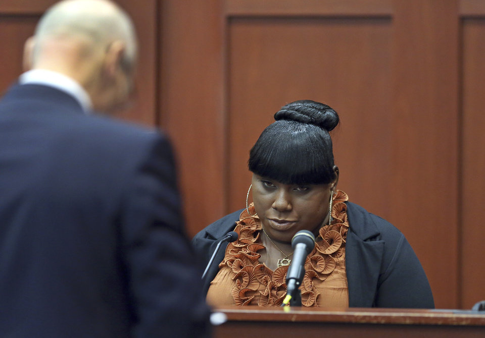 Photo - Witness Rachel Jeantel, right, continues her testimony to defense attorney Don West on day 14 of George Zimmerman's trial in Seminole circuit court in Sanford, Fla. Thursday, June 27, 2013. Zimmerman has been charged with second-degree murder for the 2012 shooting death of Trayvon Martin.(AP Photo/Orlando Sentinel, Jacob Langston, Pool)