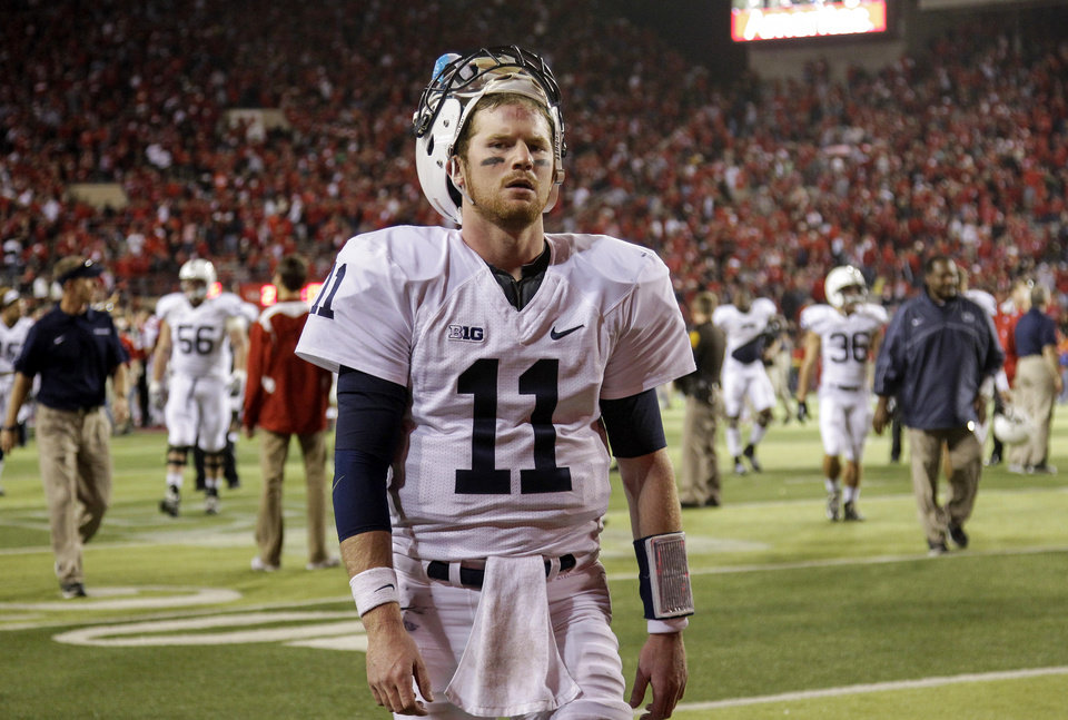 Penn State quarterback Matthew McGloin walks off the field following an NCAA college football game against Nebraska, Saturday, Nov. 10, 2012, in Lincoln, Neb. Nebraska won 32-23. (AP Photo/Nati Harnik)