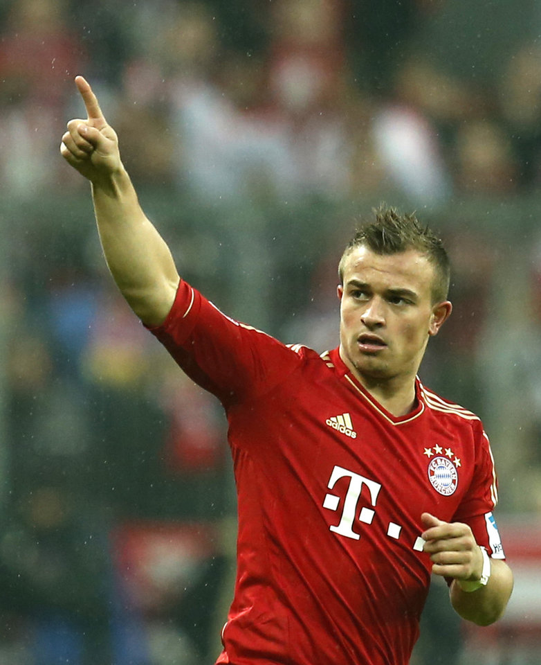 Bayern's Xherdan Shaqiri of Switzerland celebrates after scoring during the German first division Bundesliga soccer match between FC Bayern Munich and Hamburger SV, in Munich, southern Germany, on Saturday, March 30, 2013. (AP Photo/Matthias Schrader)