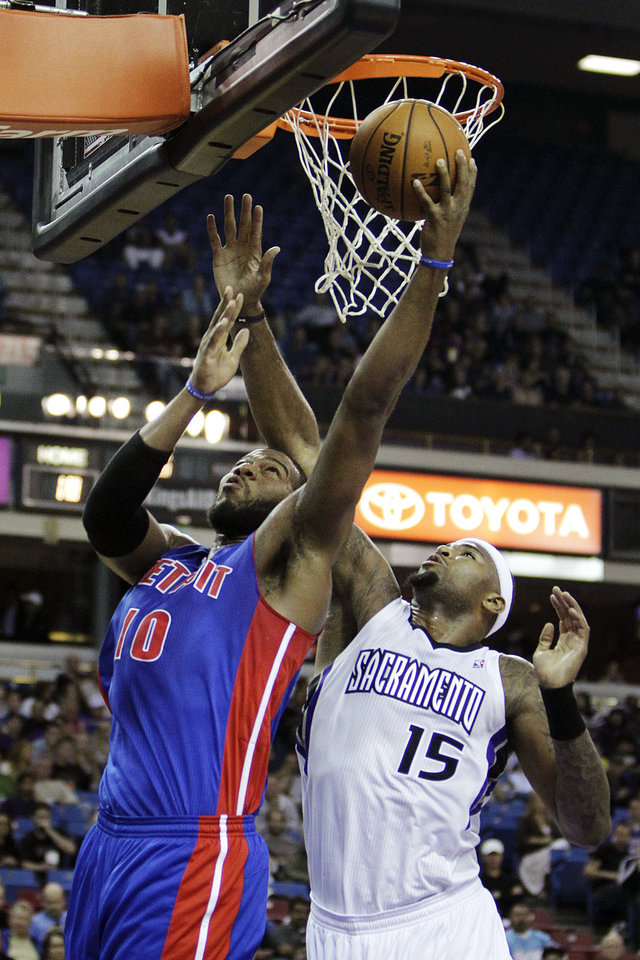 Detroit Pistons center Greg Monroe, left, goes the basket against Sacramento Kings center DeMarcus Cousins (15) during the first quarter of an NBA basketball game in Sacramento, Calif., Wednesday, Nov. 7, 2012. (AP Photo/Rich Pedroncelli)