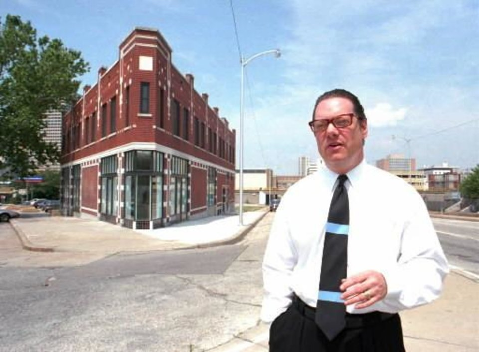 Photo -  Rand Elliott at the Heierding Building after completing renovations, 1995.