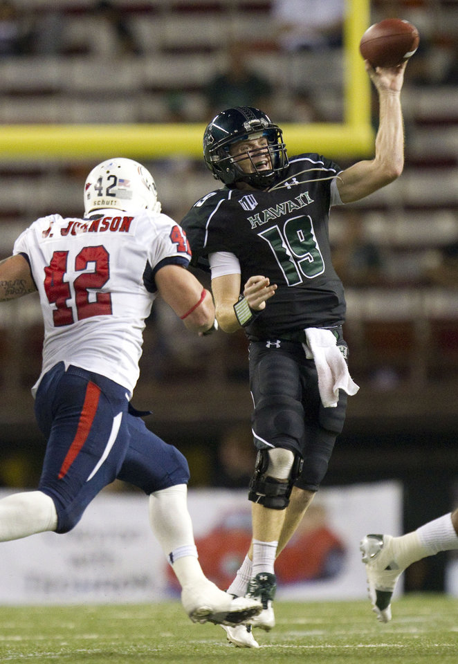 Southern Alabama inside linebacker Jake Johnson (42) puts on the pressure as Hawaii quarterback Sean Schroeder (19) throws a pass in the second quarter of an NCAA college football game Saturday, Dec. 1, 2012, in Honolulu. (AP Photo/Eugene Tanner)