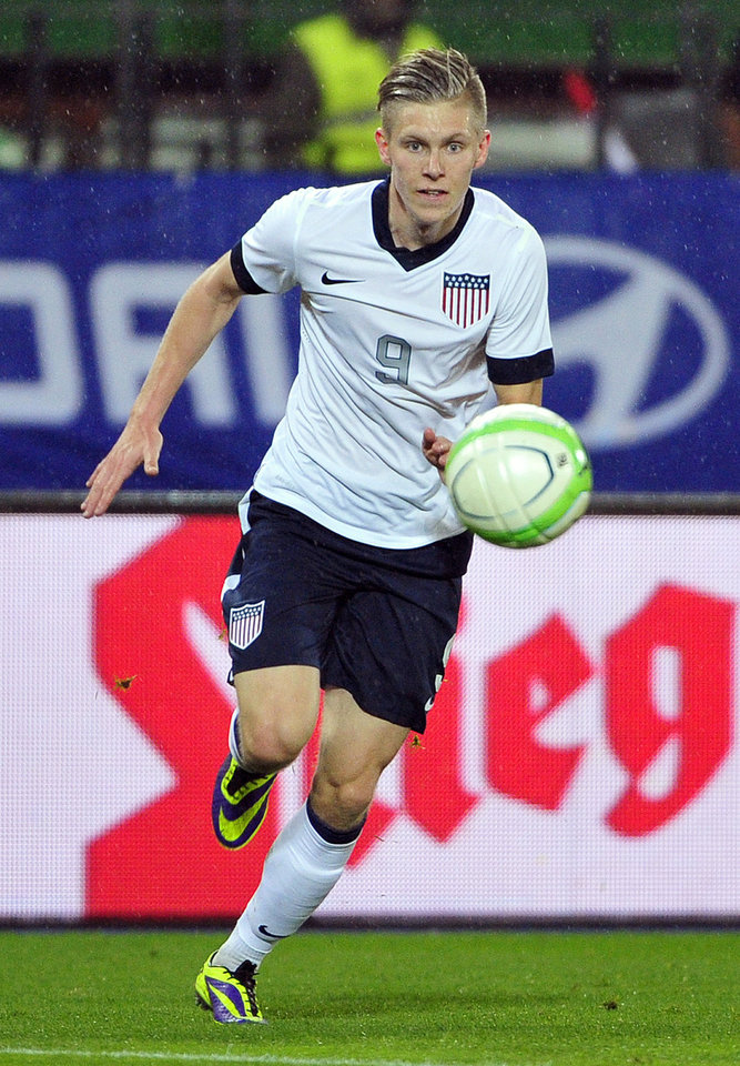Photo - FILE - In this Nov. 19, 2013 file photo, U.S. national soccer team player Aron Johannsson moves the ball during a friendly soccer match against Austria in Vienna, Austria.  Born in Alabama, Johannsson moved to Iceland at age 3. The speedy young forward, who scored 26 goals for his Dutch club team AZ, figures he might be able to sway some Icelandic fans now and get them to cheer for him as he heads to Brazil as part of coach Jurgen Klinsmann's 23-man roster announced Thursday.  (AP Photo/Hans Punz, File)