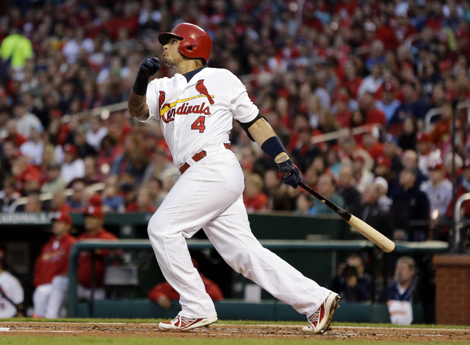 Photo - St. Louis Cardinals' Yadier Molina watches his three-run home run during the first inning of a baseball game against the Milwaukee Brewers, Tuesday, April 29, 2014, in St. Louis. (AP Photo/Jeff Roberson)