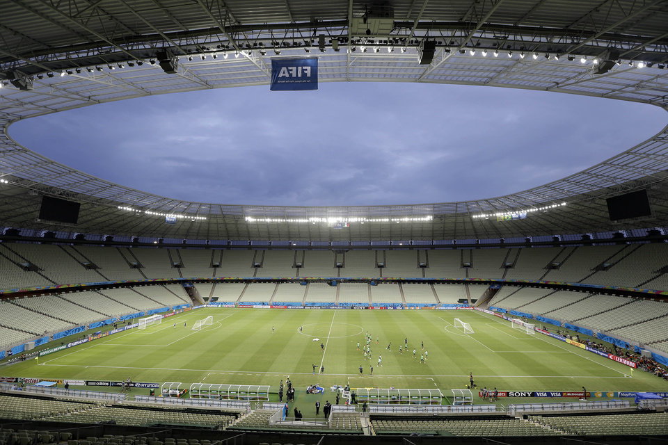 Photo - Mexican players exercise during an official training session, the day before the group A World Cup soccer match between Brazil and Mexico, at the Arena Castelao in Fortaleza, Brazil, Monday, June 16, 2014.  (AP Photo/Andre Penner)