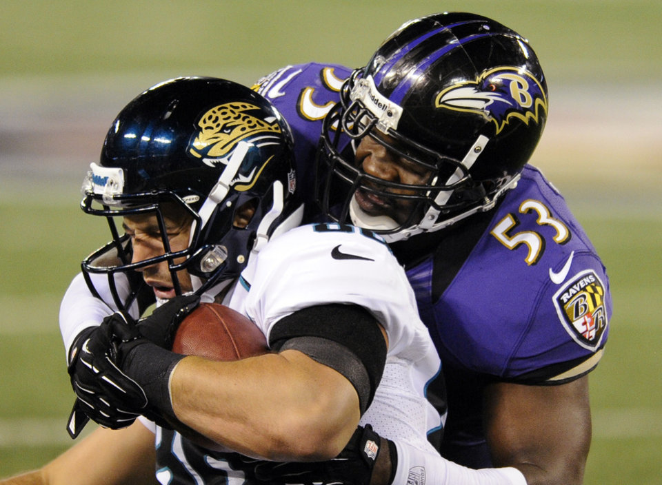 Photo -   Baltimore Ravens linebacker Jameel McClain (53) tackles Jacksonville Jaguars tight end Zach Miller in the first half of an NFL preseason football game in Baltimore, Thursday, Aug. 23, 2012. (AP Photo/Nick Wass)