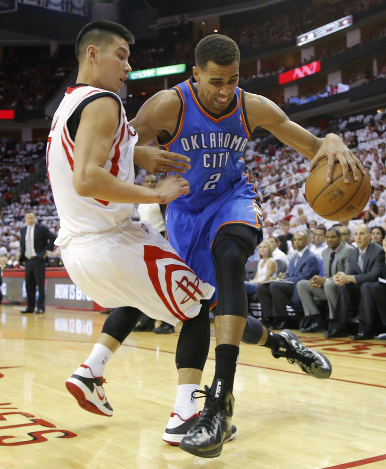 Oklahoma city\'s Thabo Sefolisha tries to get past Houston\'s Jeremy Lin during Game 3 in the first round of the NBA playoffs between the Oklahoma City Thunder and the Houston Rockets at the Toyota Center in Houston, Texas, Sat., April 27, 2013. Photo by Bryan Terry, The Oklahoman