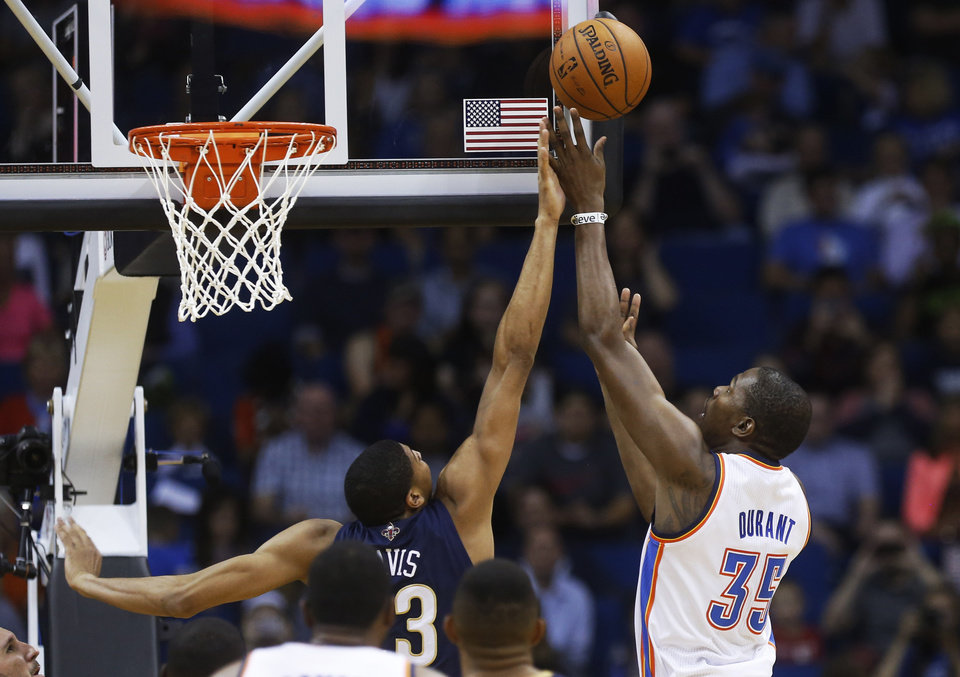 New Orleans Pelicans forward Anthony Davis (33) blocks a shot by Oklahoma City Thunder forward Kevin Durant (35) in the second quarter of an NBA basketball preseason game in Tulsa, Okla., Thursday, Oct. 17, 2013. (AP Photo/Sue Ogrocki) ORG XMIT: OKSO107