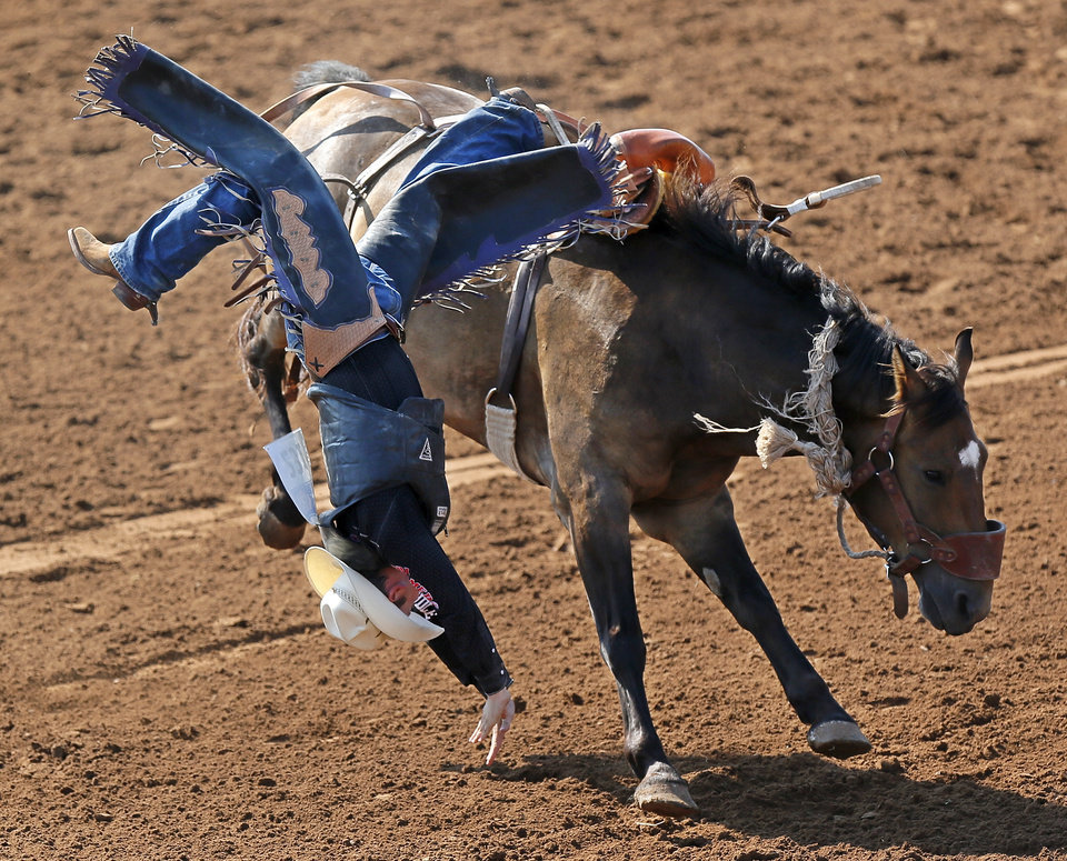 Lane Hamm of Minneapolis, Kansas, is bucked off while competing in saddle bronc during the International Finals Youth Rodeo at the Heart of Oklahoma Exposition Center in Shawnee, Okla., Thursday, July 12, 2012. Photo by Nate Billings, The Oklahoman