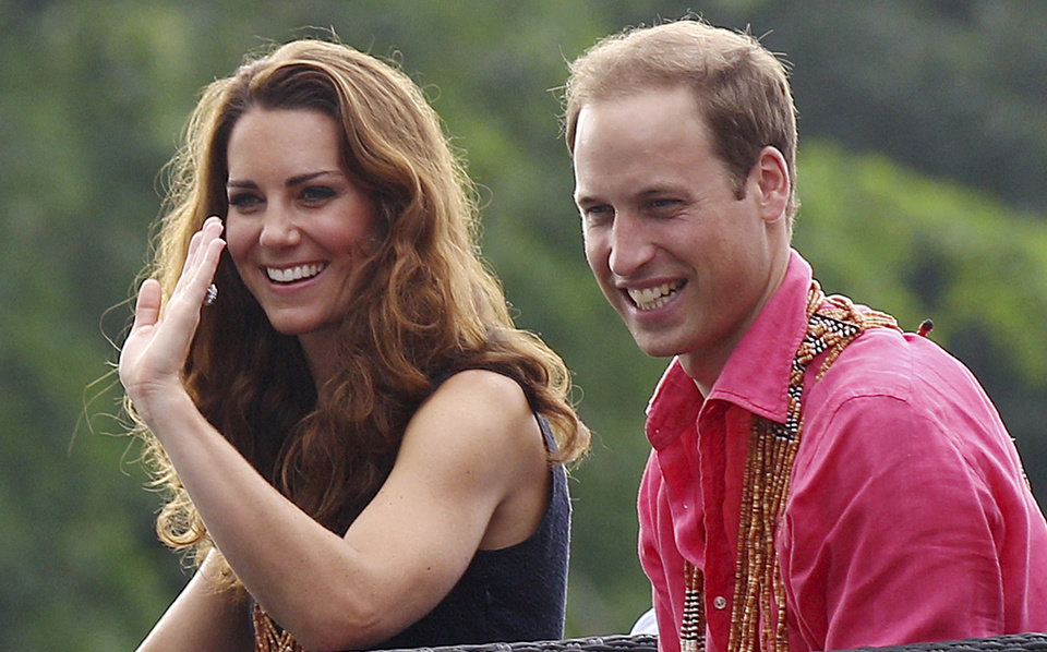 Photo -   Britain's Prince William and his wife Kate, the Duke and Duchess of Cambridge, smile as they watch a shark ceremony as they arrive at Marapa Island, Solomon Islands, Monday, Sept. 17, 2012. (AP Photo/Rick Rycroft, Pool)