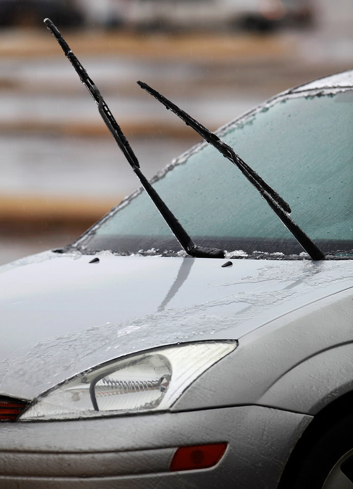 Photo - Wipers pulled away from this car's windshield in a parking lot near NW 58 and May Ave, Thursday,  Jan. 28, 2010. Photo by Jim Beckel, The Oklahoman
