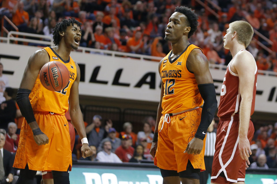 Photo - Oklahoma State's Kalib Boone (22) and Cameron McGriff (12) celebrate beside Oklahoma's Brady Manek (35) during an NCAA men's Bedlam basketball game between the Oklahoma State University Cowboys (OSU) and the University of Oklahoma Sooners (OU) at Gallagher-Iba Arena in Stillwater, Okla., Saturday, Feb. 22, 2020. Oklahoma State won 83-66. [Bryan Terry/The Oklahoman]