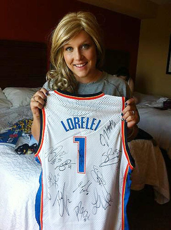 Photo - Lorelei Decker shows off her signed Oklahoma City Thunder jersey.  PROVIDED
