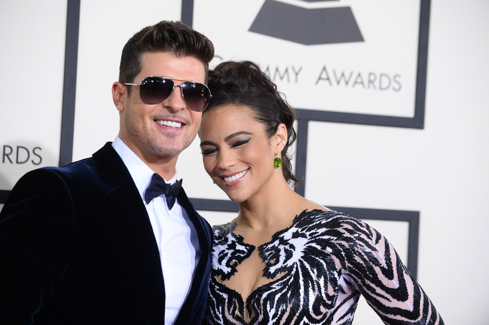 Photo - Robin Thicke, left, and Paula Patton arrive at the 56th annual Grammy Awards at Staples Center on Sunday, Jan. 26, 2014, in Los Angeles. (Photo by Jordan Strauss/Invision/AP)