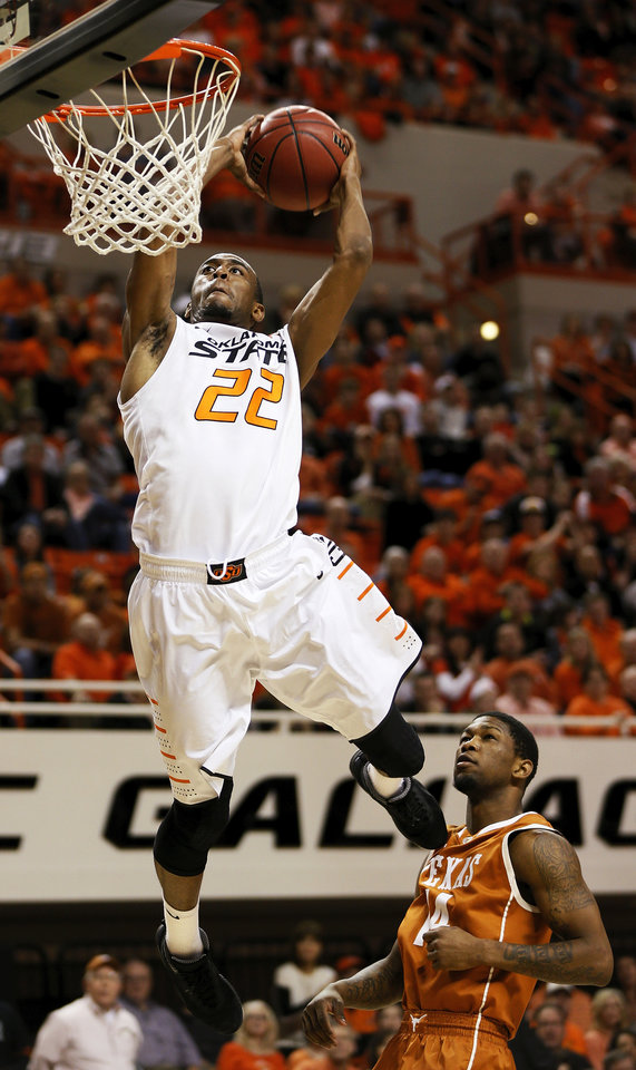 Oklahoma State\'s Markel Brown (22) dunks the ball in front of Texas\' Julien Lewis (14) during a men\'s college basketball game between Oklahoma State University (OSU) and the University of Texas at Gallagher-Iba Arena in Stillwater, Okla., Saturday, March 2, 2013. Photo by Nate Billings, The Oklahoman