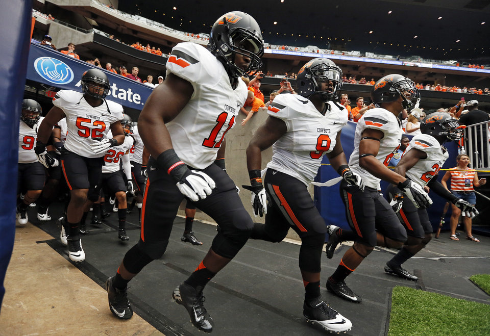 The OSU Cowboys take the field before the AdvoCare Texas Kickoff college football game between the Oklahoma State University Cowboys (OSU) and the Mississippi State University Bulldogs (MSU) at Reliant Stadium in Houston, Saturday, Aug. 31, 2013. Photo by Nate Billings, The Oklahoman