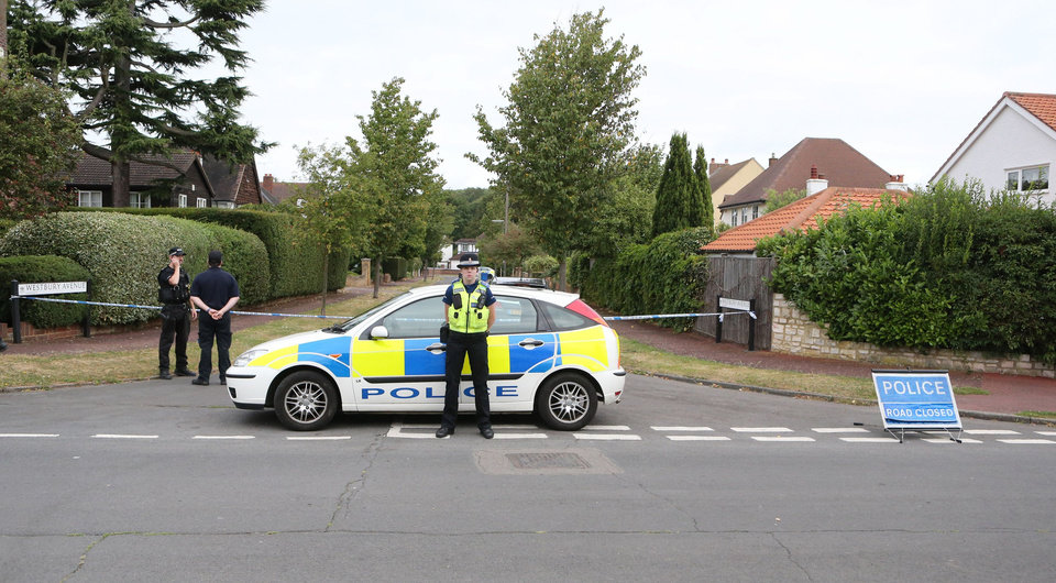 Photo -   The home of Saad al-Hilli, in Claygate, England, who was shot dead with three others while vacationing in the French Alps, continues to be guarded by Surrey Police, who are assisting French police, Monday Sept. 10, 2012. Authorities say they are probing whether an alleged financial dispute between Saad al-Hilli and his brother Zaid played a role, though the surviving brother has denied any conflict. (AP Photo/PA, Steve Parsons) UNITED KINGDOM OUT NO SALES NO ARCHIVE