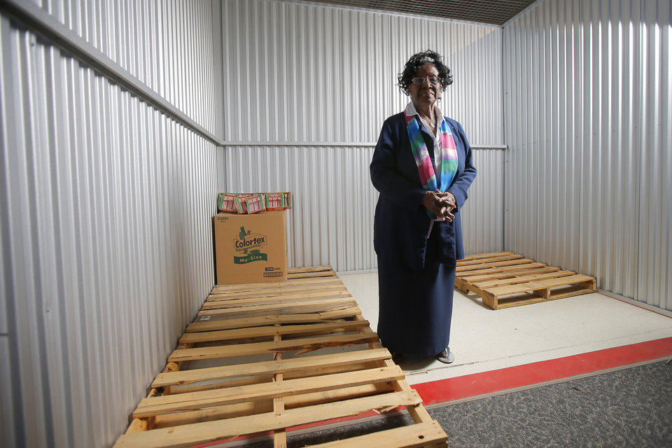 Photo -  Mable Stoss, founder and director of the Free Food Pantry and Educational Center, stands inside an empty storage unit. [PHOTO BY BRYAN TERRY, THE OKLAHOMAN]