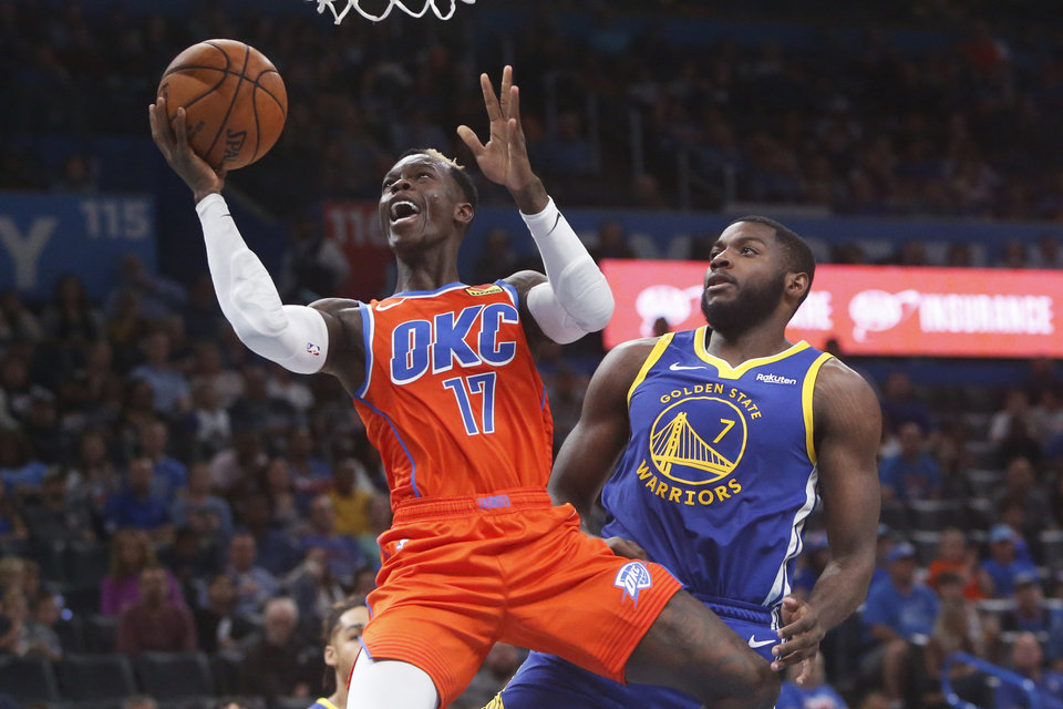 Photo - Oklahoma City Thunder guard Dennis Schroder (17) shoots in front of Golden State Warriors forward Eric Paschall (7) in the second half of an NBA basketball game Sunday, Oct. 27, 2019, in Oklahoma City. (AP Photo/Sue Ogrocki)
