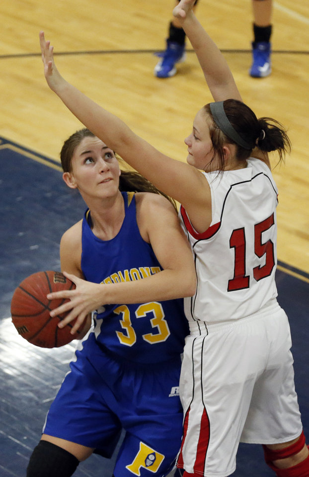 Photo - Piedmont's Sarah Parker (33) looks to shoot the ball past McLoud's Brook Johnson (15) during a basketball tournament at the Kingfisher High School gym on Thursday, Jan. 24, 2013, in Kingfisher, Okla.  Photo by Chris Landsberger, The Oklahoman