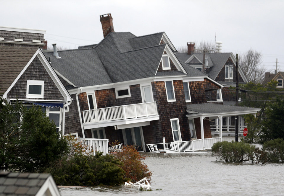 Floodwaters surround homes near the Mantoloking Bridge the morning after superstorm Sandy rolled through, Tuesday, Oct. 30, 2012, in Mantoloking, N.J. Sandy, the storm that made landfall Monday, caused multiple fatalities, halted mass transit and cut power to more than 6 million homes and businesses. (AP Photo/Julio Cortez) ORG XMIT: NJJC122