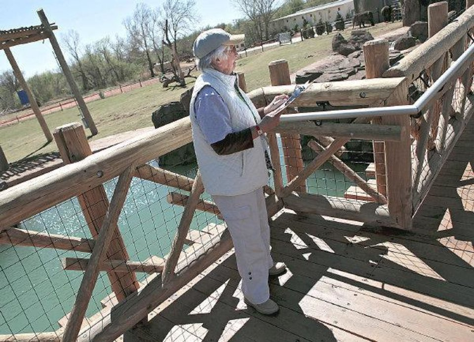 Volunteer Nancy Adams watches Asha and keeps notes on her progress at the new Elephant Exhibit on Tuesday, April 5, 2011. Volunteers and staff are keeping a 24-hour watch on Asha as her due date gets closer. Photo by John Clanton, The Oklahoman ORG XMIT: KOD